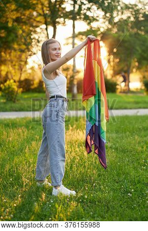 Side View Of Tolerant Girl Posing With Colorful Scarf In Summer Park, Sunset On Background. Gorgeous