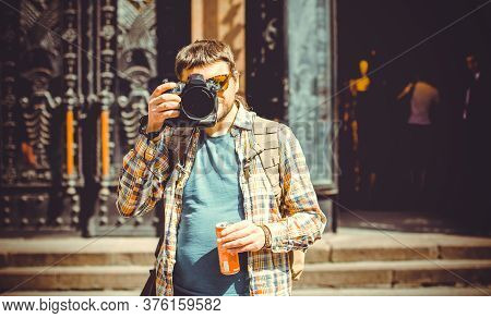 A Man With A Camera Walks Around The City Photographing The Neighborhood. The Tourist Came To See Eu