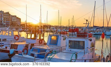Fishing boats in the port of Heraklion at sunset,  Crete island, Greece. Picturesque greek scenery