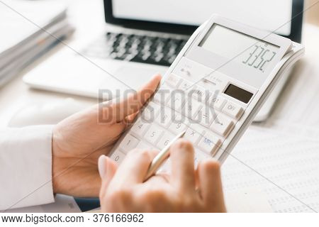 Close Up Businessman Hand Using Calculator And Writing Make Note With Calculate About Finance Accoun