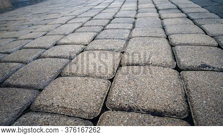 Detail Of Vintage Traditional Stone Pavement In Perspective. Abstract Background Of Old Cobblestone
