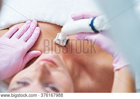 Adult woman in beauty salon undergoing face hydrogen purification