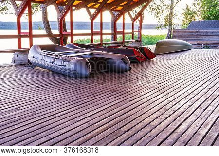 A Canopy For Drying Boats In A Fishing Village. Under The Roof Are Two Inflatable Fishing Boats And