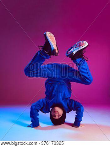 Boy Child Breakdancer Stands On Head Dancing Hip Hop In Neon Light. Dance School Poster. Battle Comp