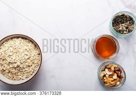Ingredients For Healthy Homemade Granola With Gluten Free Rolled Oats Or Porridge Oats, Variety Of C