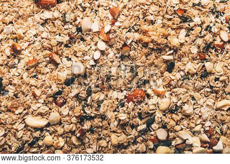 Raw Healthy Homemade Granola With Gluten Free Rolled Oats Or Porridge Oats, Variety Of Chopped Nuts