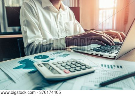 Businessman Accountant Or Financial Expert Analyze Business Report Graph And Finance Chart At Corpor