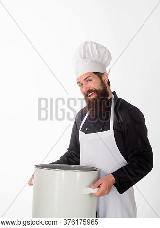 Dinnerware. Male Chef Cook Holds Big Pot. Cook Man In Apron Holds Saucepan. Cooking Pot. Saucepan. C