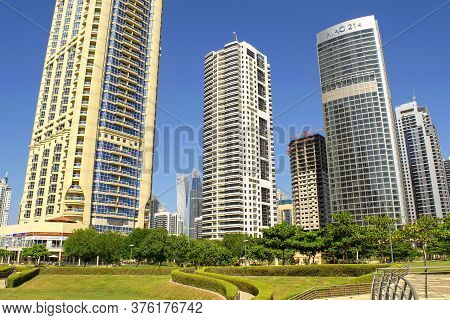 Dubai / Uae - October 15, 2019: View Of Jumeirah Lakes Towers Skyscrapers And Park During Day. Resid