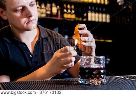 Bartender Is Making Cocktail At Bar Counter. Fresh Cocktails. Barman At Work.