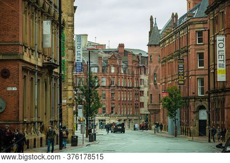 MANCHESTER, UK - FEB 24, 2020: Manchester city urban street view with architecture in England, United Kingdom