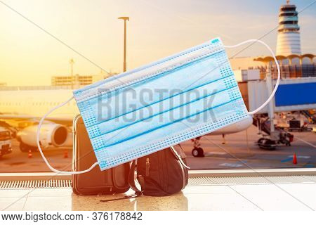 Coronavirus Security Restrictions In Airports Concept. Business Man Suitcase And Bag Against Air Pla