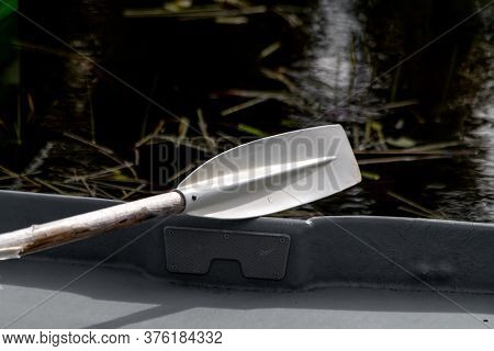 White Boat Oar On A Boat. Recreation By The Lake. Boat Equipment
