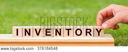 Inventory Word Written On Wood Block. Man Hand Holding Wooden Cube Block With Inventory Business Wor