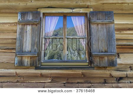 Window of a typical mountain hut in Italy, Europe