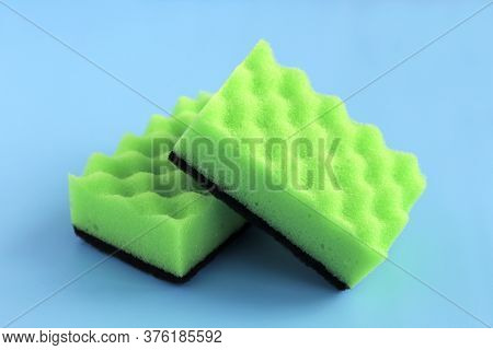 Dishwashing Sponge. Two Green Sponges For Washing Dishes And Other Surfaces On A Blue Background. Cl