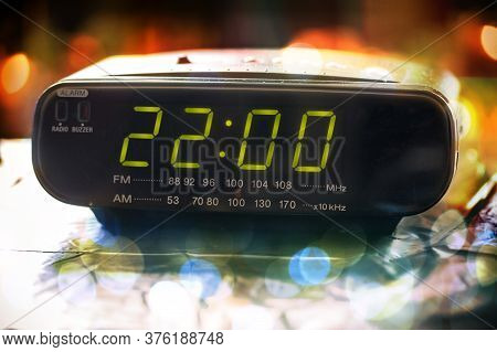 Black Digital Alarm Radio Clock. Alarm Radio Clock Indicating Time To Wake Up. Digital Clock Display