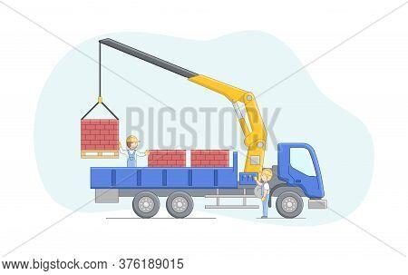 Construction Concept. Crane Driver And Worker Work Together. Manipulator Crane Unloads Bricks On Pal