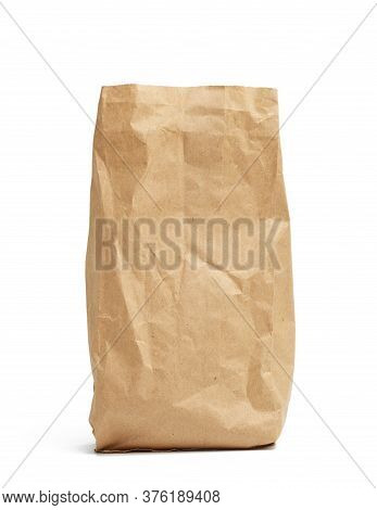 Paper Disposable Bag Of Brown Kraft Paper Isolated On White Background, Concept Of Rejection Of Plas