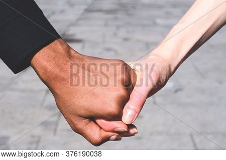 Honding Hands Caucasian And African American Women. Concept Of Multiculturalism And Friendship