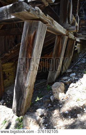 Rotting And Leaning Support Beams Of An Old Mining Building Dangers Collapse Of The Structure,