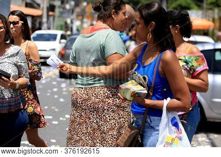 Salvador, Bahia / Brazil - October 2, 2016: Person Is Seen Doing Distribution Of Political Propagand