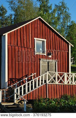 Front View Of Finnish Traditional Red Wooden Shed