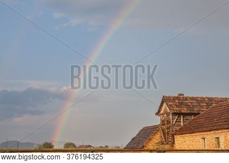 Rainbow In A Field Of Uljma, In The Agricultural Region Of Banat, Province Of Voivodina, In A Field,