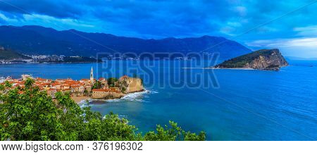 Panoramic View Of Budva Old Town With The Citadel And The Adriatic Sea In Montenegro On The Balkans