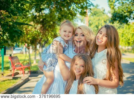 Happy Family Photo. Closeup Portrait Photo Toothy Smiling Three Little Cute Girls, Her Mother Four M