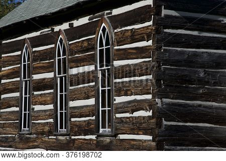 Building Feature Of The Weathered Wooden Log Cabin Church.