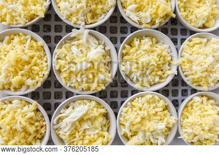 Cheese On White Bowl / Cheddar Cheese Grated For Cooked Food , Top View