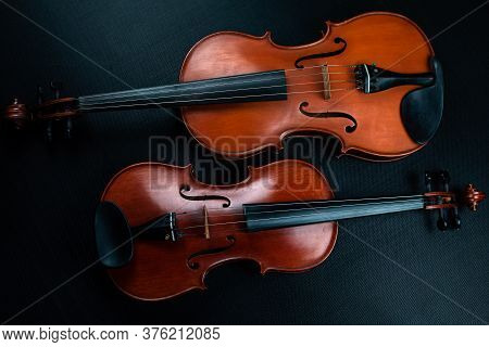 Violin And Viola Put On Background,show Front Side Of Acoustic Instrument