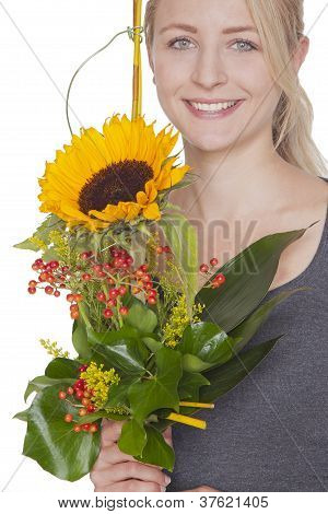 blond woman with sunflower bouquet