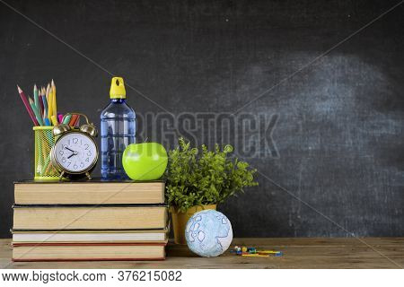 Education Concept - Books On The Desk In The Auditorium. School Books On Desk Or Back To School On B