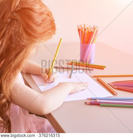 Little Girl Drawing. Closed Locking Exercise. Homemade Routine. School Lessons. Write Pencil On Piec