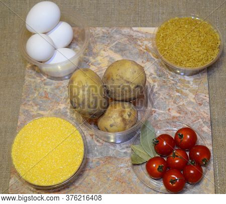Ingredients For Quick Cooking Of The Second Course For Lunch: Eggs, Potatoes, Bulgur, Cherry Tomatoe