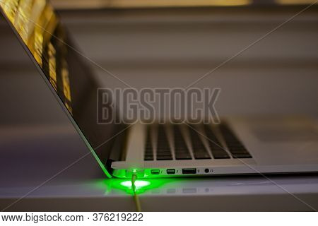 Calgary, Alberta. Canada. July 14, 2020. Macbook Computer Charging During The Night Side View Magsaf