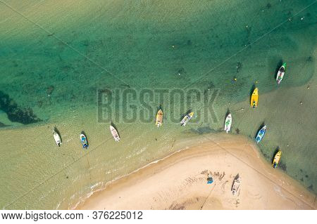 Small Fishing Boats Anchored In A Shallow Lagoon, Aerial Image.