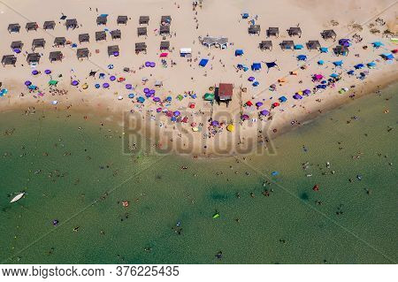 Crowded Public Beach With Colourful Umbrellas, Aerial View.