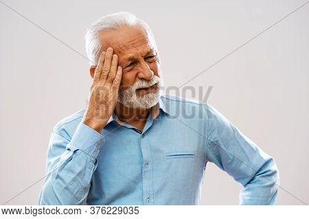Portrait Of Senior Man Who Is Having Headache.