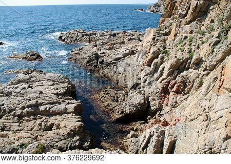 Rocky Coast Of The Mediterranean Sea Beautiful View Of Rocks With Blue Sea With Waves Under Sunshine