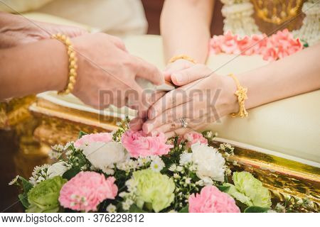 Watering The Conch Shell In A Thai Wedding Ceremony.