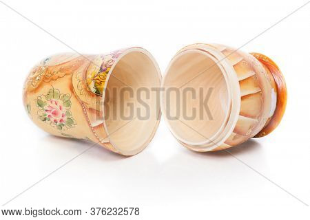 Single Russian nesting doll (also named as Matrioshka) isolated over white background. Wooden doll souvenir.