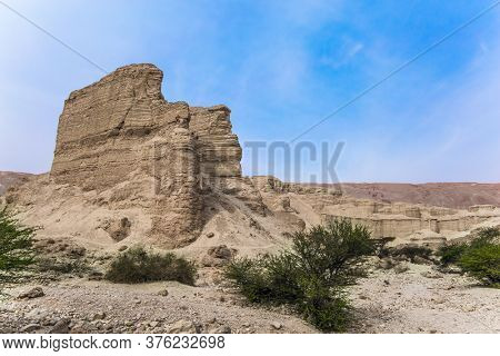 Clear winter morning. Coast of the famous and healing Dead Sea. Picturesque stone canyon in the mountains of the Judean desert. Israel. Ecological, active and photo tourism concept