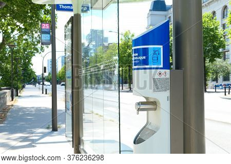 Paris, France. July 11. 2020. Hydro Alcoholic Gel Dispenser Fixed To The Structure Of A Bus Station.