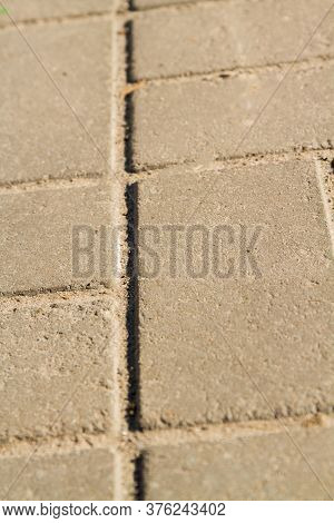 Close-up Gray Square Pavement Slabs. Clinker Pavement Made Of Cobblestones.