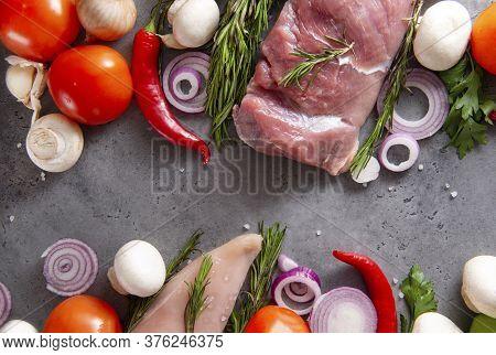 Raw Meat, Chicken Fillet, Pork Tenderloin With Tomato, Onion, Chili Pepper,  Greens, Rosemary, Mushr