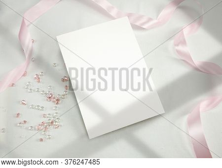 Invitation Mockup. Top View Blank Card On White Background And Window Shadow With Clipping Path.