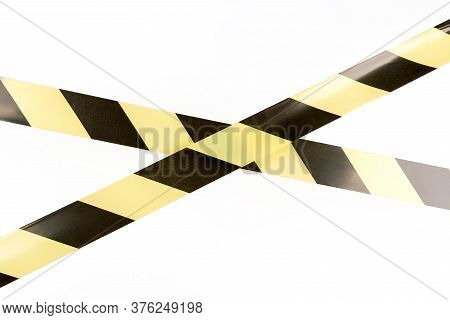 Black And Yellow Restrictive Tape On A White Background. The Tape Is Crossed, Restriction